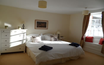 Enford House cottage twin bedroom on the ground floor so easily accessible and with beautiful views of the walled garden
