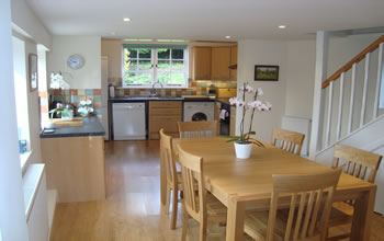 Enford House holiday cottage in Wiltshire has a well equipped kitchen  with lots of natural light and a large table