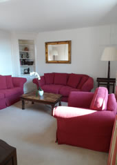 Enford House self catering holiday cottage has a beautiful garden surrounded by a thatched wall