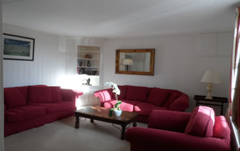 Enford House self catering holiday cottage has a spacious sitting room with 2 3 seater sofas, armchair, tv, dvd, wifi